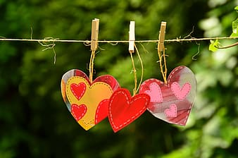 Three pink-yellow-and-red heart decors