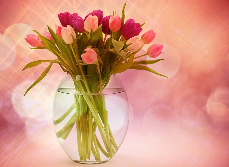 Bouquet of pink flowers in clear glass vase