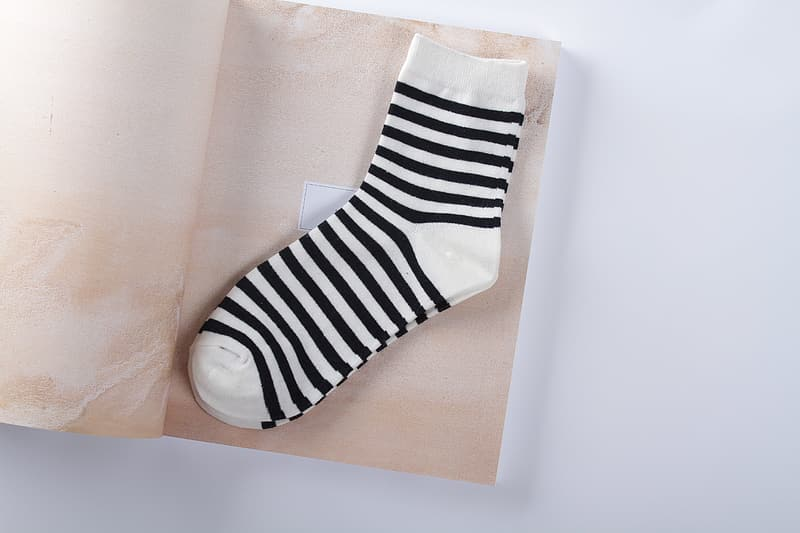 Pair of white-and-black socks on brown paper