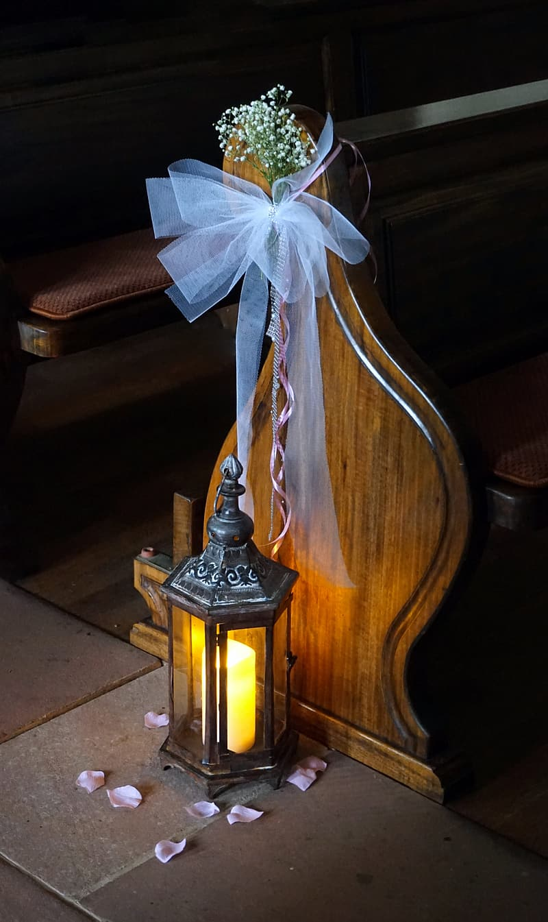 White ribbon on brown wooden table