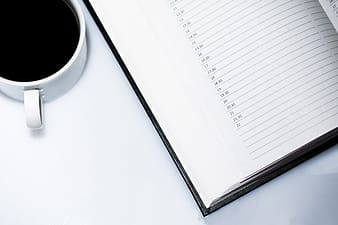 Cup of coffee and planner