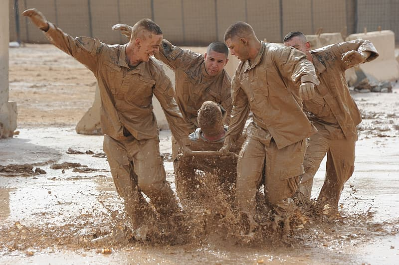Group of mens in brown mud during daytime