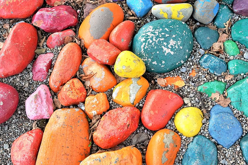 Assorted-color stone lot on sand