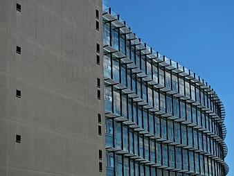 Grey and clear glass high-rise building during daytime
