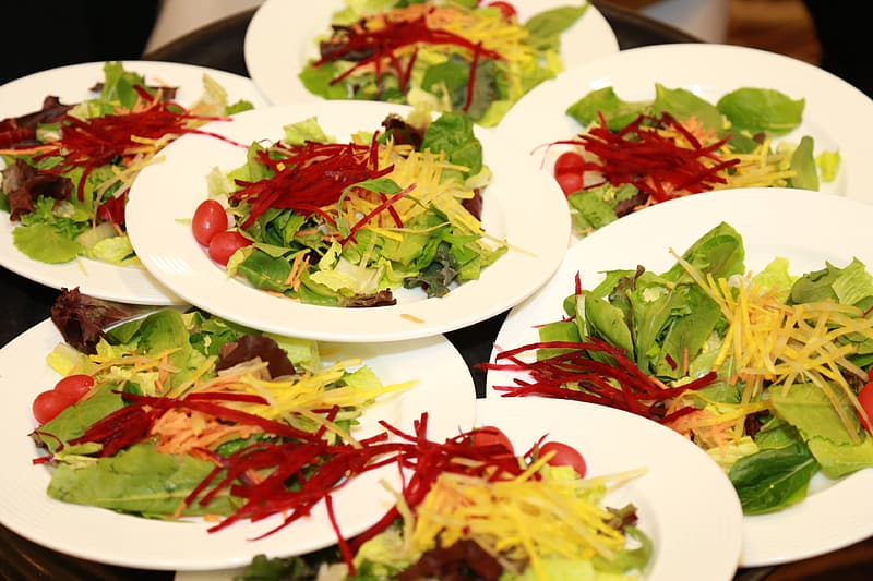 Vegetable salads and white plates