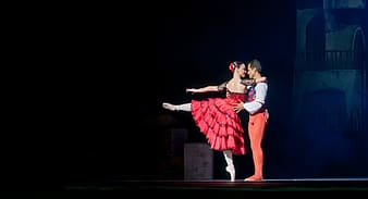 Man and woman dancing on stage