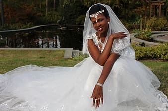 Woman wearing white lace wedding gown