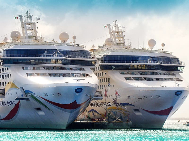Two white cruise ships on sea at daytime