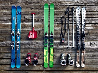 Three pairs of snow skis with bindings and ski poles