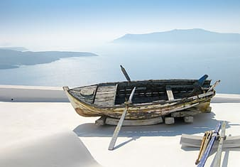 Wooden boat on white surface