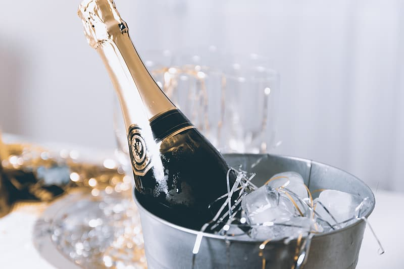 A concept of luxury life with champagne bottle in ice bucket | Pikrepo