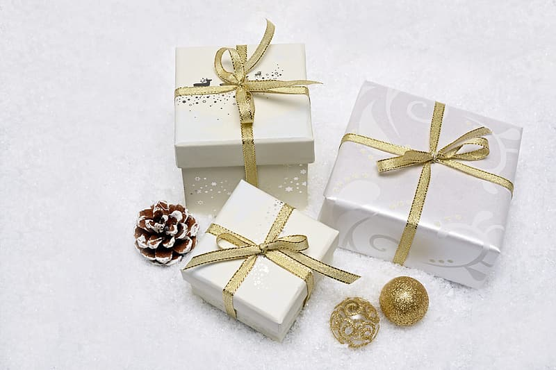 Three white and brown gift boxes