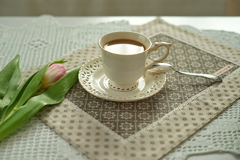 White ceramic tea cup with saucer