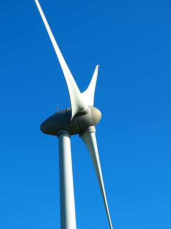 Low angle photography of white and grey windmill