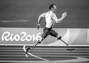 Athletic man running on track and field on Rio 2016 Olympic