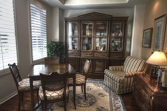 Brown wooden table with brown chairs indor