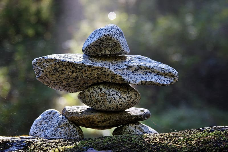 Depth of field photography of gray balancing stone