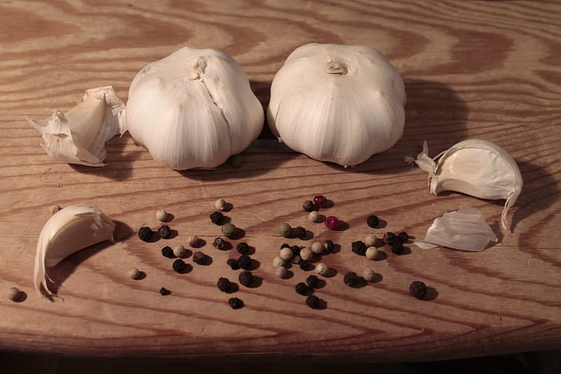 White garlic on brown wooden table