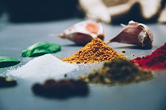 White, brown, green, and red seasoning powders