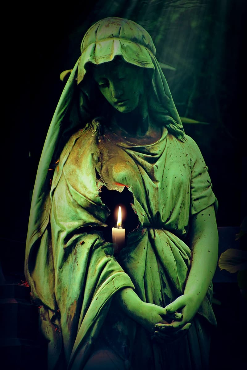 Woman statue with candle wallpaper