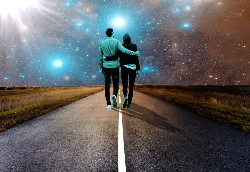Man and woman holding each other's arm walking towards road