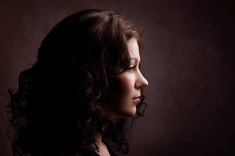 Woman with brown hair looking down