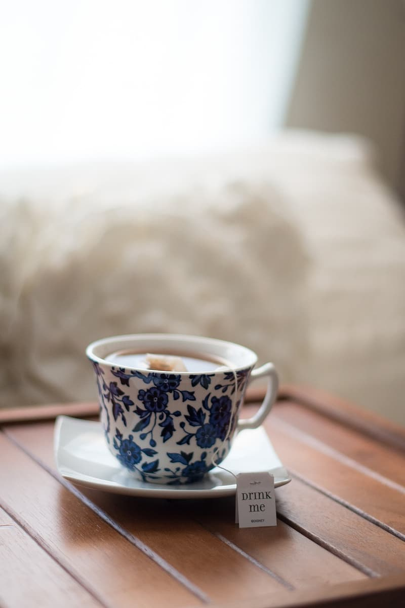 Tea on white and blue floral ceramic teacup