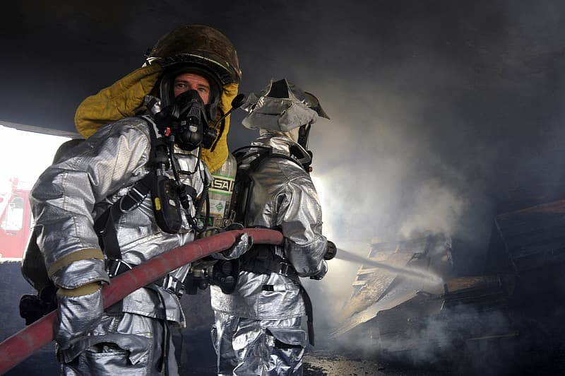 Two firefighters holding hose