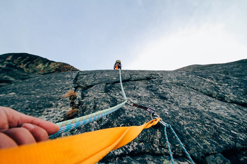 Low angle photography of a person holding harness