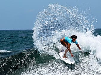 Woman surfboarding during daytime