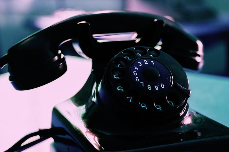 Shallow focus photography of black rotary dial phone