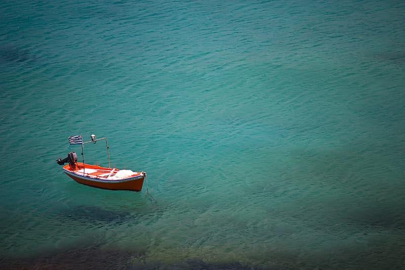 White and red boat on sea during daytime