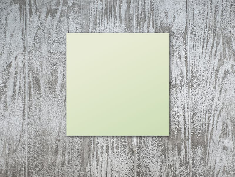 Yellow paper on gray wooden surface
