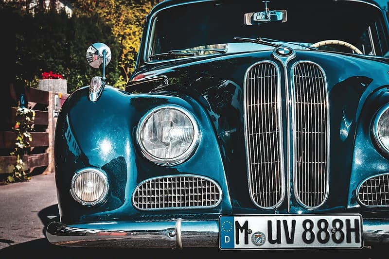 Blue classic car with white and black helmet