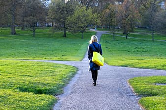 Woman walking on the pathway