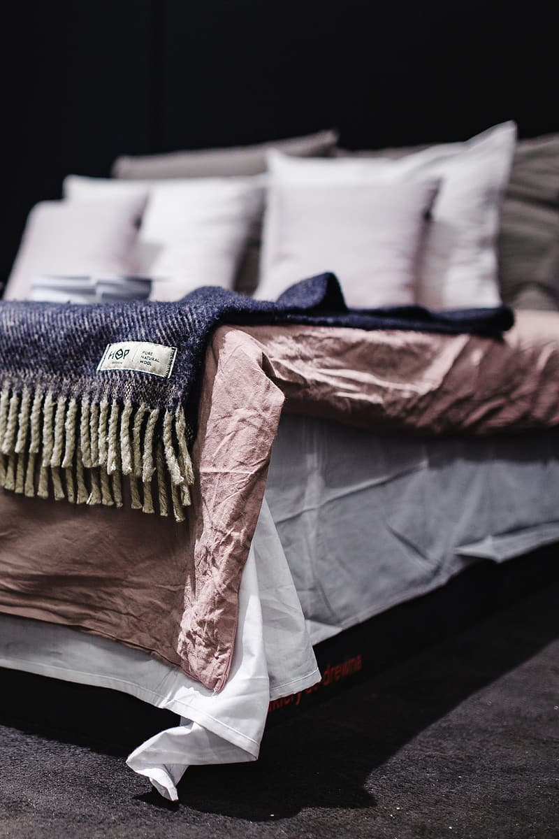 Beds with pillows on a designer exhibition