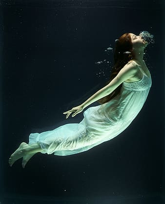 Woman wearing sleeveless dress while diving