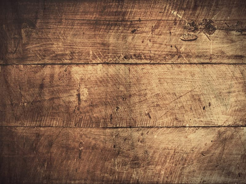 Close-up photo of brown wooden panel