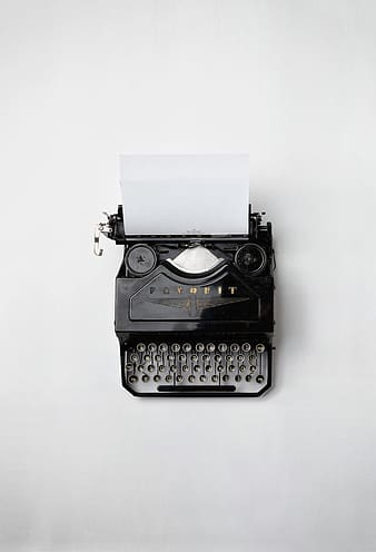 Black and silver typewriter on white table