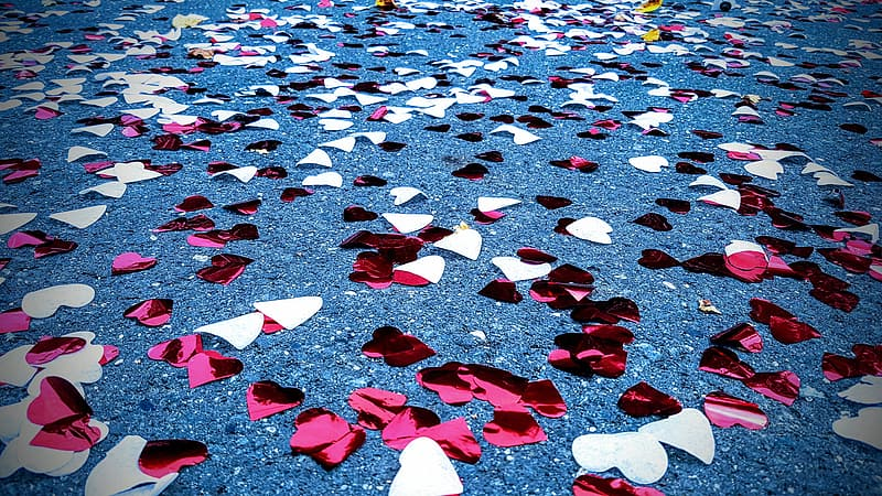 White and pink cutout foil hearts on ground