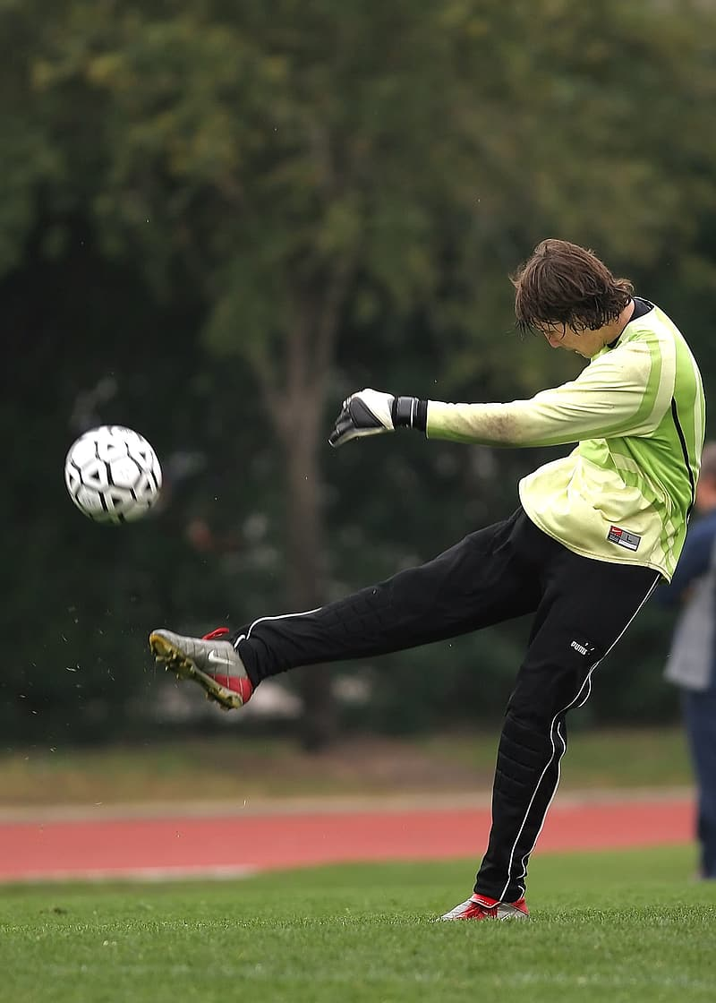 Man kicking the soccer ball