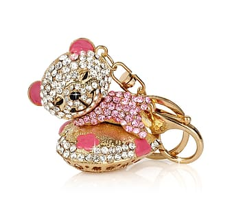 Gold-colored and pink bear pendant