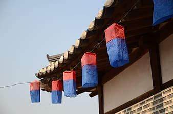 Blue and red flag on brown roof