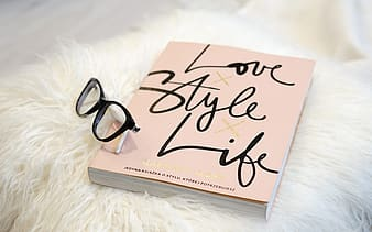 Black eyeglasses on Love Style Life book