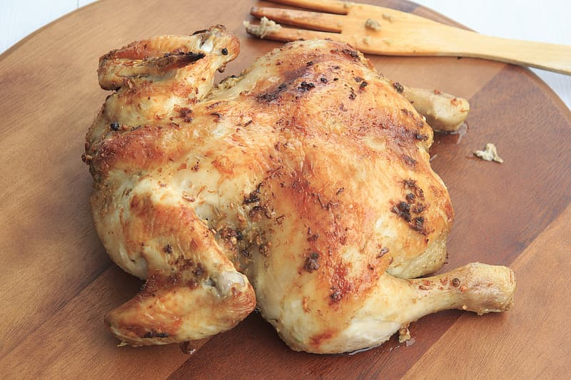Grilled chicken on brown wooden tray