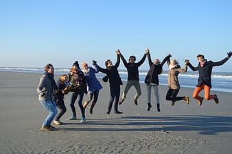 Photo of people jump on shore