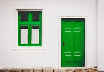 Closed green wooden 6-panel door
