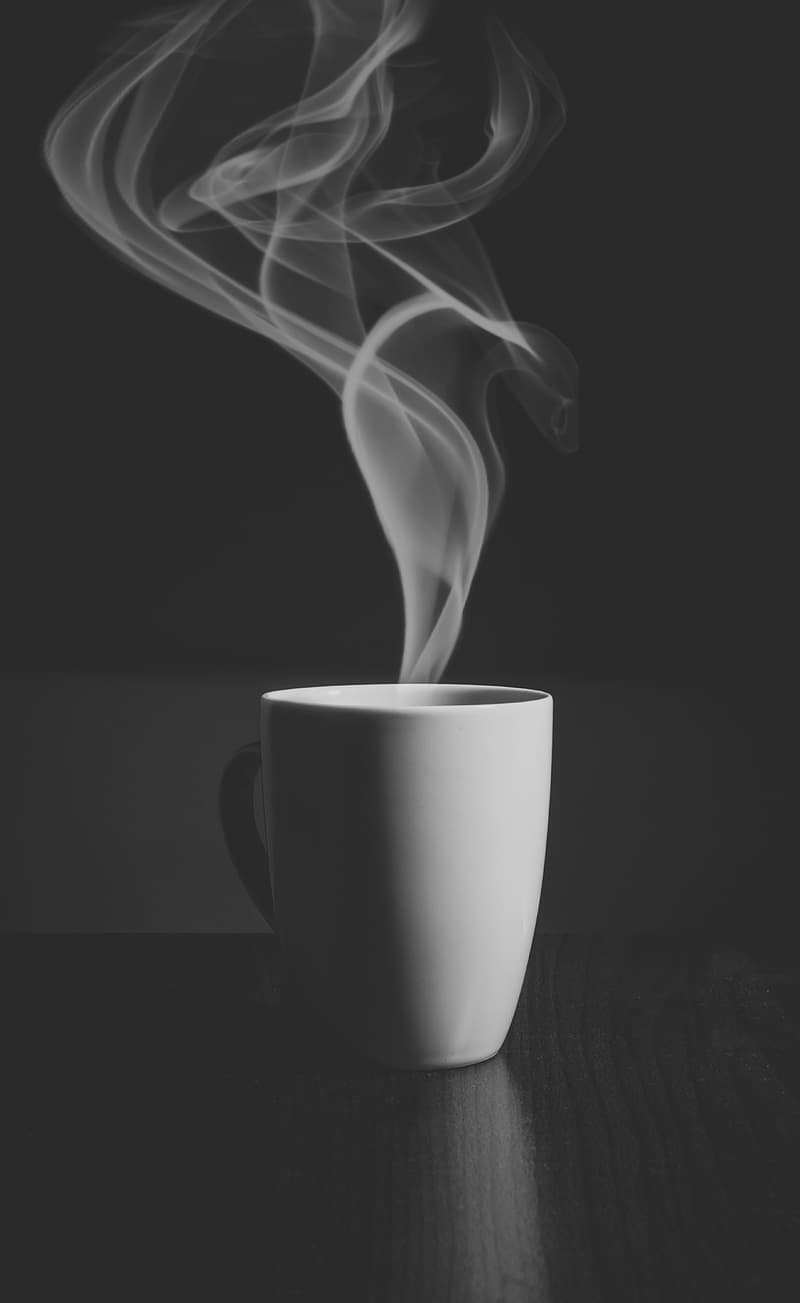 Steam going out from mug grayscale photo