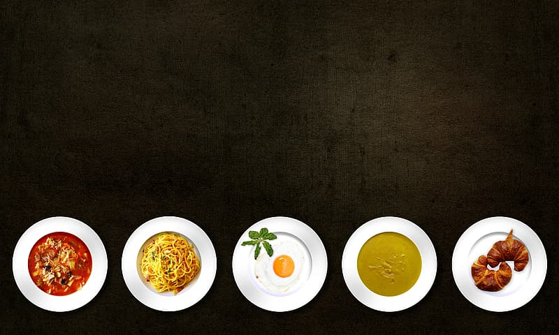 Five assorted dishes on round white ceramic plates