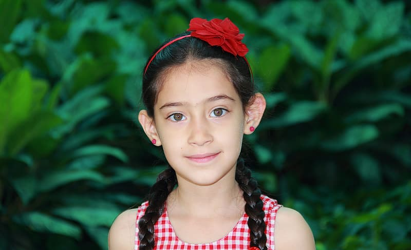 Selective focus photography of girl wearing red alice band